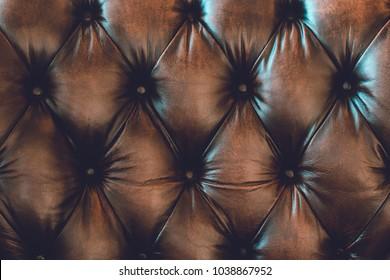 Detail of brown lether sofa for vintage background