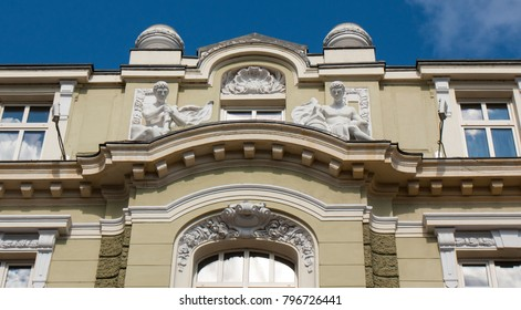 Detail of building of Bank of Sofia, landmark of architecture of beginning of 20 century, sculptures on the roof.