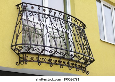 detail of building and decorative metal railing window