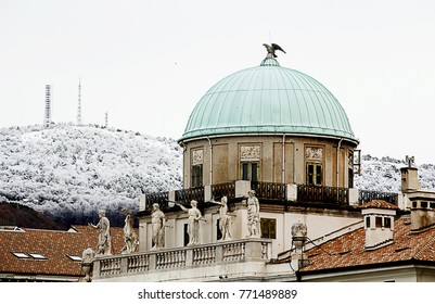 detail of building in trieste with snowy mountain kn the back