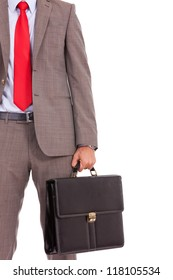 detail of a business man's suit and tie with briefcase. cutout picture of a business man holding a briefcase, isolated on white