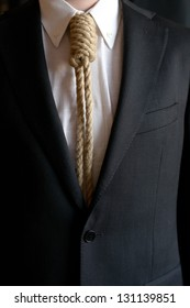 Detail of businessman with hangman's noose instead of tie symbolizing economic problems