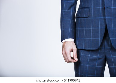 Detail of a businessman's hand with blue suit jacket