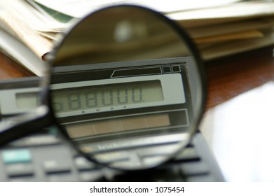 Detail of a calculator through a magnifying glass