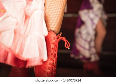 Detail of cancan dancer leg with red shoe