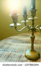 Detail of a candle holder with several used candles