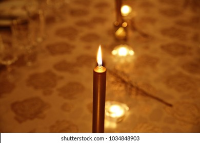 Detail of Candle on Table during Christmas Time. A peaceful scene right before dinner.