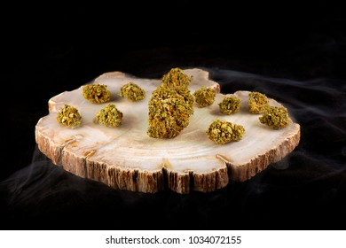 Detail of cannabis buds (day dreamer strain) with smoke isolated over black background - medical marijuana dispensary concept