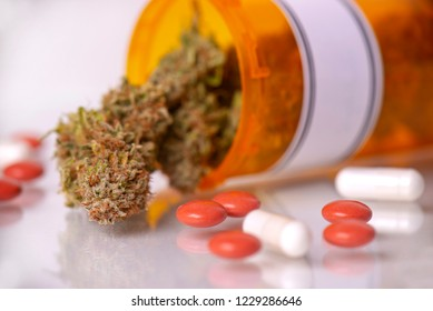 Detail of cannabis buds and prescriptions pills over white background - medical marijuana dispensary concept