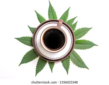 Detail of cannabis coffee cup with marijuana leaves isolated over white, marijuana edibles concept