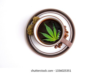Detail of cannabis coffee cup with marijuana leaves and coffee beans isolated over white, marijuana edibles concept