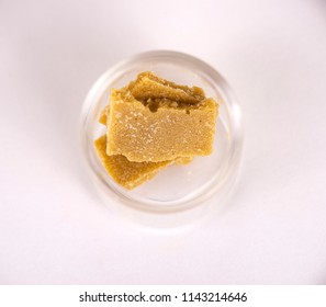 Detail of cannabis concentrate extracted from the marijuana plant for medical use, isolated over white background