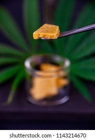 Detail of cannabis concentrate extracted from the marijuana plant for medical use, isolated over dark background