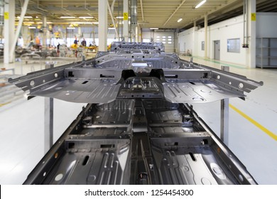 Detail of car closeup. process of welding cars. Modern Assembly of cars at plant. automated build process of car body