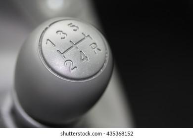 detail of a car interior, stick shift car