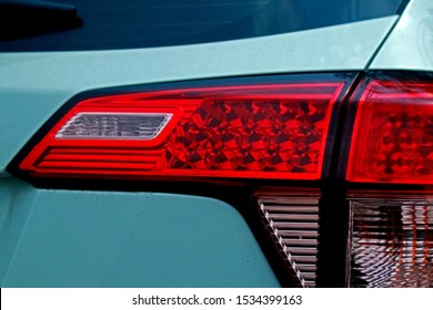 Detail of car taillight on the road