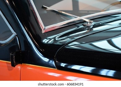 Detail of car windscreen and shining hood