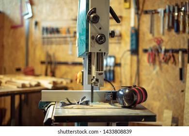 detail of carpenter tool bandsaw in workshop