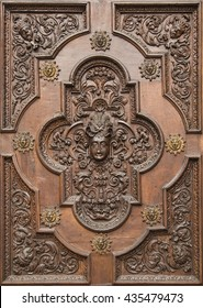 Detail of the carved wooden gate of the Catholic shrine of the Madonna di Tirano, a town in Valtellina, located in the province of Sondrio in northern Italy