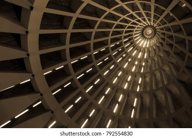 Detail of the ceiling of a modern building. Lines in prespective shaped by external sunlight. Useful background.