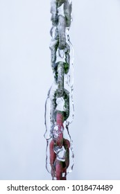 Detail of a chain covered with fresh ice