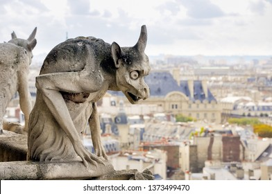 Detail of a Chimera sculpture (often confused with a Gargoyle), in Notre-Dame Cathedral, in Paris, France