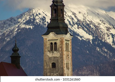 Detail church and alps in winter in Bled