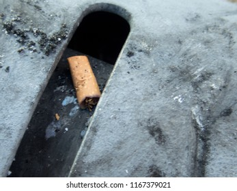 detail of cigarette butt in an ashtray