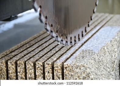detail of a circular saw used to cut granite