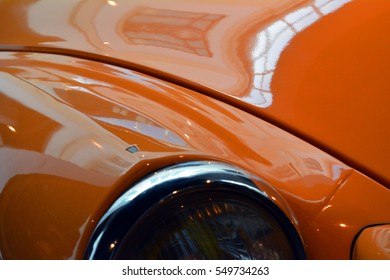 Detail of classic shining orange car hood