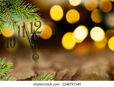 Detail of clock face and Christmas twig before midnight