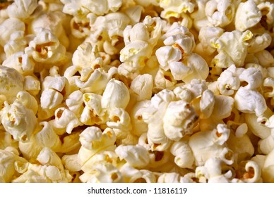 Detail close up of fresh popped buttered popcorn