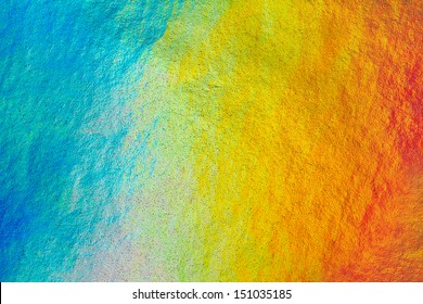 Detail close up of metallic paper in rainbow colors, as a colorful structured background image