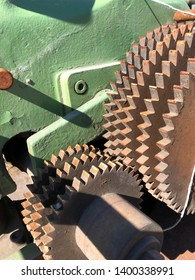 Detail and close up of rusty cogs on a saw and planer machine.