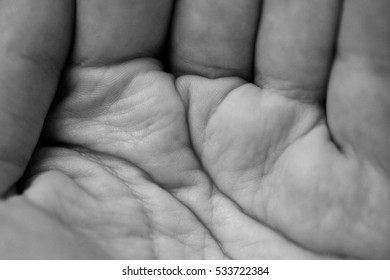 Detail of closed hand man with soft and deep skin folds