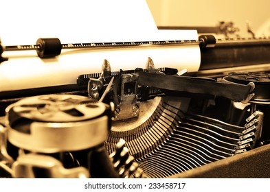 Detail closeup of old typewriter with paper for writing communication