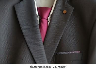 Detail closeup, close-up of suit jacket lapel button hole fabric, selective focus
