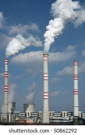 detail of coal power plant with chimney and cooling towers