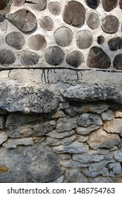 Detail of a cob wall and stone basis