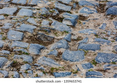 Detail of a cobbelstone road located in the North of France near Lille. On such roads every year is organized one of the most famous one day cycling race Paris-Roubaix.