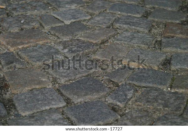 A detail of a cobblestone road.  Good for a background or texture image.