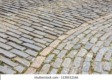 Detail of a cobblestone street in the Old Port district of Portland, Maine, USA, for background or texture with urban, vintage, or travel motifs