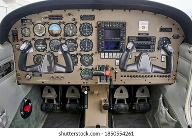 Detail of the cockpit of the old plane. Aircraft equipment, various indicators, buttons, instrument pedals. Aircraft instrument panel at the pilot school.