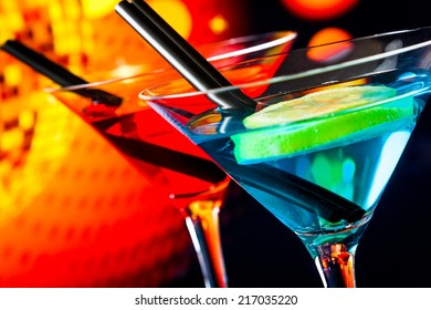 detail of cocktail with sparkling disco ball background with space for text, dance disco concept