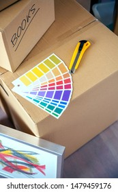 Detail of color palette and cutter over moving boxes