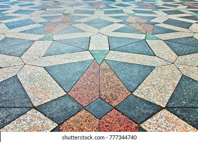"""Detail of the colored stone paving of the beautiful square """"Amagertorv"""", along the Stroget road, made of triangular and polygonal granite stones (Europe - Denmark - Copenhagen)"""
