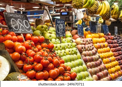 Detail of a colorful fruit market interior, prices in euro