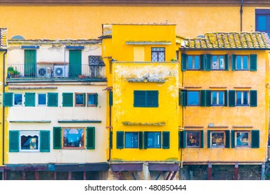 detail of colorful houses on the ponte vecchio bridge in the italian city florence