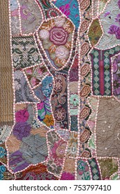 Detail of a colorful patchwork carpet . Close up