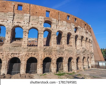 Detail of Colosseum or gladiator Arena famous stony ancient architecture. Arches of Flavian Amphitheatre. Construction of antique Roman Empire. Arena Flavio or Coliseum, iconic symbol of Imperial Rome